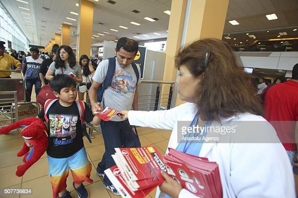 Personnel of Peruvian Health Ministry fumigate hands out papers to inform the community about the Aedes aegypti mosquito vector of the Zika virus in...