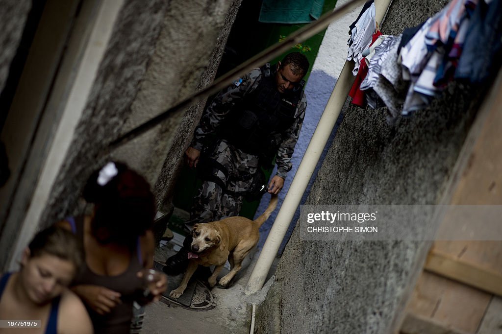 Personnel of the Canine Operations Unit (BAC) carry out an operation at Guararapes shantytown on April 29, 2013 before the specially-trained police force known as Police Pacification Units or UPP, can be deployed in. The operation, jointly held by Rio de Janeiro's feared military police battalion BOPE, the Shock Battalion and the BAC, is part of a government strategy designed to combat crime and reassert full control of the Rio de Janeiro metropolis ahead of the upcoming FIFA Confederations Cup, the football World Cup of 2014 and the Olympic Games two years later.