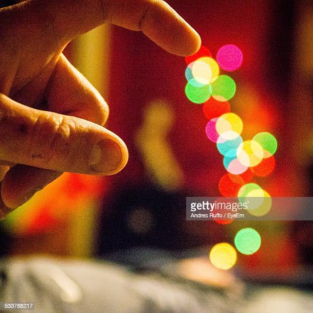 Persons Hand Showing Abstract Spotted Lighting