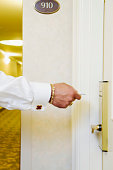 Person's hand using a cardkey to open the door