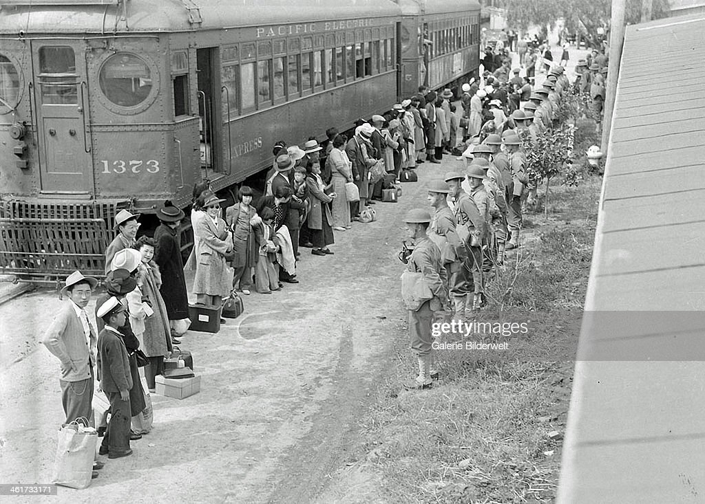 Persons of Japanese ancestry from San Pedro California arrive at the Santa Anita Assembly center in Arcadia California 1942 Evacuees lived at this...