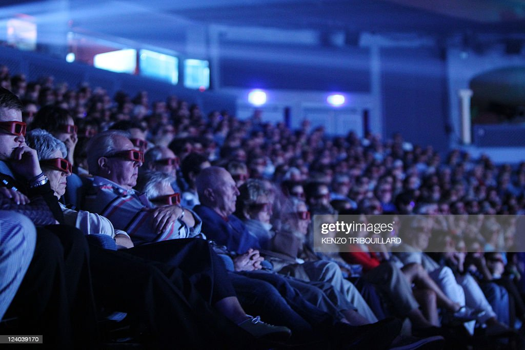Persons wearing 3D glasses watch the movie 'Fright Night', in Deauville, northwestern France, on September 3, 2011 during the 37th edition of the US film festival.