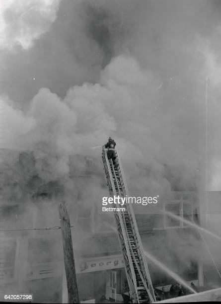 PersonToPersonIn Toxic CloudlandHempstead New York Flames and poison smoke roar from the twostory furniture store in Hempstead as a fire[fighter]...
