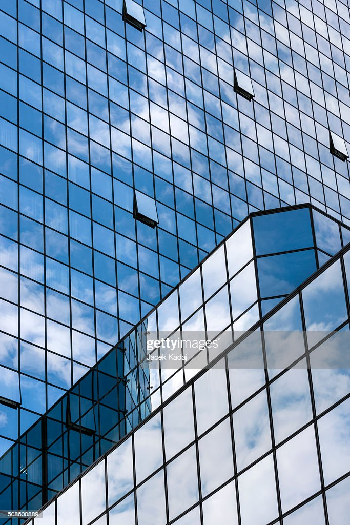 Perspective view to steel blue glass building skys : Stock Photo