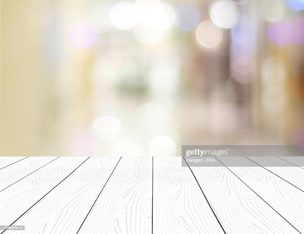 Perspective White Wood And Blurred Store With Bokeh Background Stock