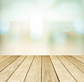 Perspective wood and blurred store with bokeh background, product display template