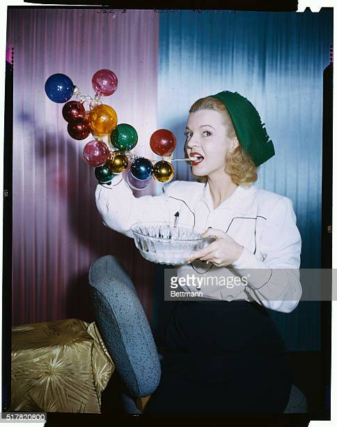 Pert Dale Evans the Queen of the Westerns who won a soap bubble blowing contest when she was a kid in Texas tries her hand at wafting soap suds into...