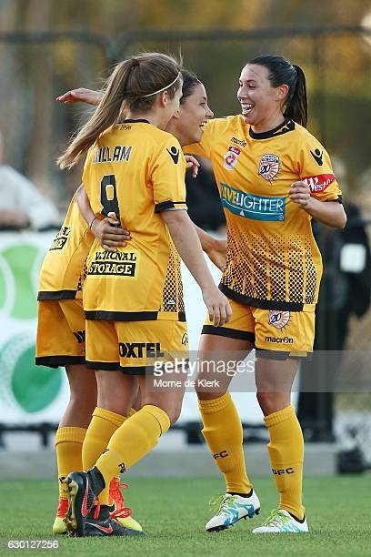Pert players celebrate with teammate Samantha Kerr of Perth Glory after she scored a goal during the round seven WLeague match between Adelaide and...