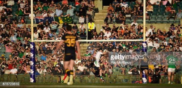 Perth Australia 18 November 2017 Ireland goalkeeper Niall Morgan saves at the hands of Chad Wingard of Australia during the Virgin Australia...