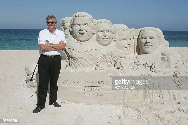 International golfer Colin Montgomerie of Scotland stands by a sculptor of himself Michael Campbell Retief Goosen Adam Scott in sand at Cottesloe...