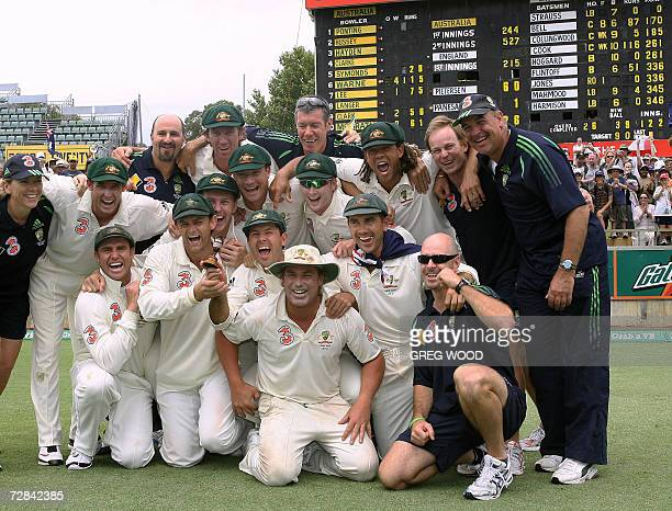 The Australian team celebrate in front of the scoreboard with the Ashes urn replica after beating England on the final day of the third Ashes Test in...