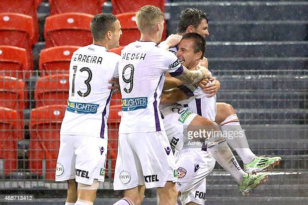 Perth Glory celebrate a goal during the round 24 ALeague match between the Newcastle Jets and Perth Glory at Hunter Stadium on April 6 2015 in...