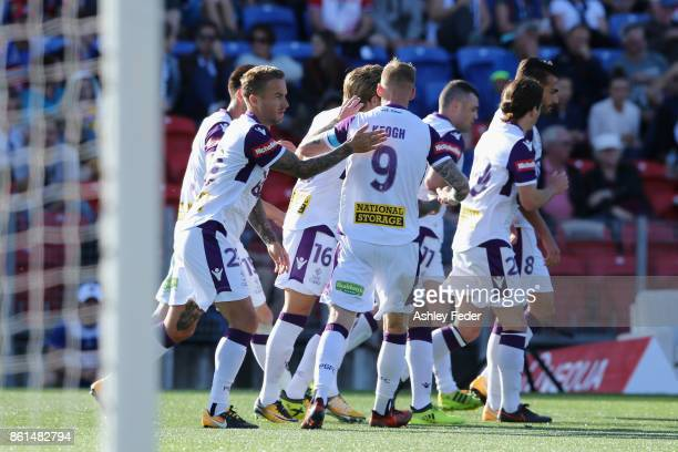 Perth Glory celebrate a goal from Adam Taggart during the round two ALeague match between the Newcastle Jets and Perth Glory at McDonald Jones...