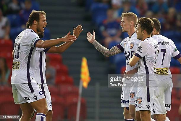Perth Glory players celebrate a goal during the round 25 ALeague match between the Newcastle Jets and the Perth Glory at Hunter Stadium on March 26...
