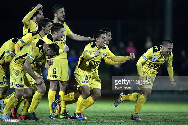 Perth Glory players celebrate after winning in a penalty shoot out during the FFA Cup match between Newcastle Jets and Perth Glory at Magic Park...