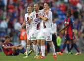 Perth Glory players celebrate the win over the Jets during the round 13 ALeague match between the Newcastle Jets and Perth Glory at Hunter Stadium on...