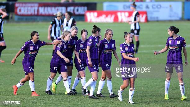 Perth Glory teammates celebrate a goal during the round two WLeague match between the Newcastle Jets and the Perth Glory at Magic Park on September...