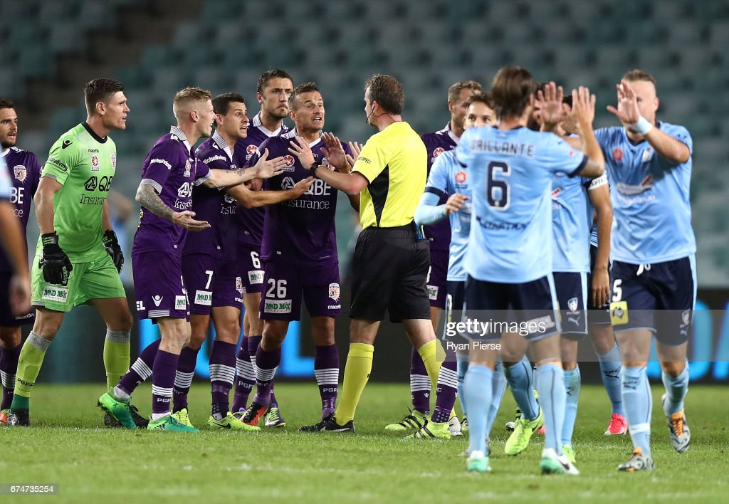 Perth players surround referee Peter Green after a video referee decision during the A-League Semi Final match between Sydney FC and the Perth Glory at Allianz Stadium on April 29, 2017 in Sydney, Australia.