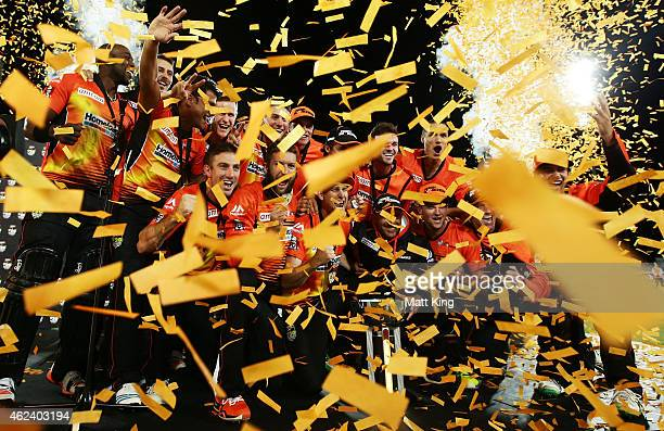 Perth Scorchers players celebrate victory with the Big Bash League trophy after winning the Big Bash League final match between the Sydney Sixers and...