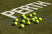 Perth signage and tennis balls are pictured on the court following the reverse singles match between Nick Kyrgios of Australia and Sanjar Fayziev of...