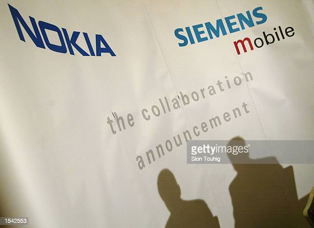 Pertti Korhonen Senior Vice President for Mobile Software at Nokia and Maurice Van Riek Senior Vice President for Mobile Phones 3G and Convergence at...