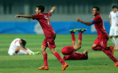 Peru celebrate after they defeat Korea Republic 21 in the final match during the 2014 FIFA Boys Summer Youth Olympic Football Tournament Gold/Silver...