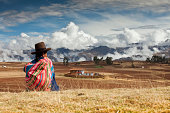 Peru, Chinchero, Indian woman and mountains