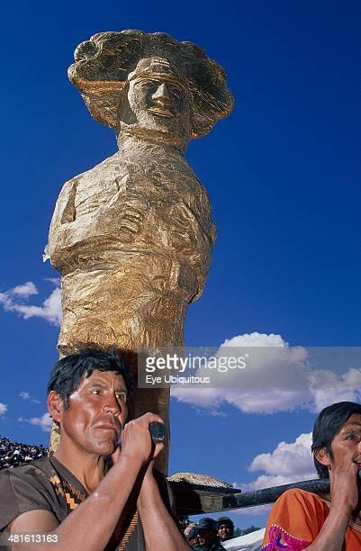 Peru Cusco Department Cusco Young men carrying a golden Inca statue at Inti Raymi