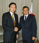 LIMA Peru Former Japanese Prime Minister Yukio Hatoyama and incoming Peruvian President Ollanta Humala shake hands as they meet in Lima on July 27...