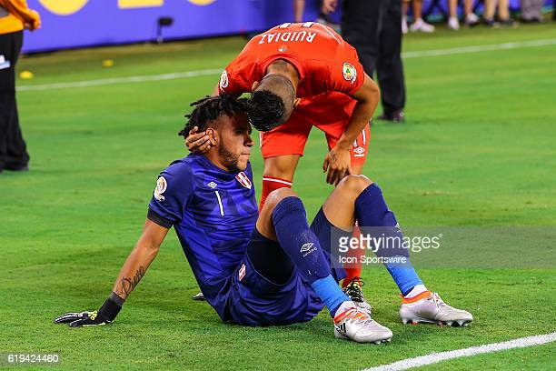 Peru goalkeeper Pedro Gallese gets consoled by teammate Peru forward Raul Ruidiaz after losing the 2016 Copa America Centinario Quarterfinal game...