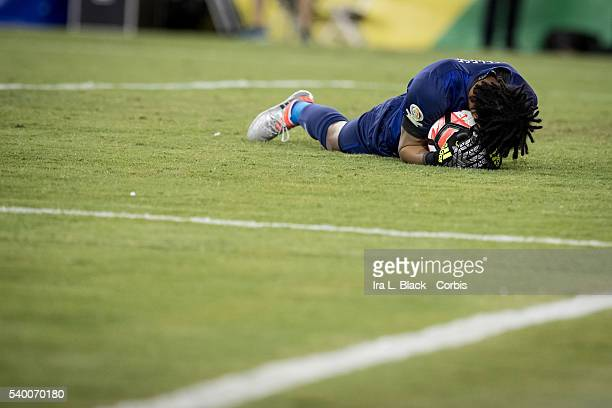 Peru national team goalkeeper Pedro Gallese holds the ball tightly after stopping another advance by Brazil during the Soccer 2016 Copa America...