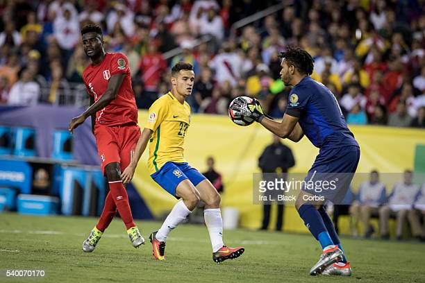 Peru national team goalkeeper Pedro Gallese stops the advance by Brazil player Philippe Coutinho during the Soccer 2016 Copa America Centenario Group...