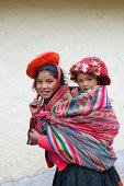 Peru, Patacancha, Indian girl carrying baby