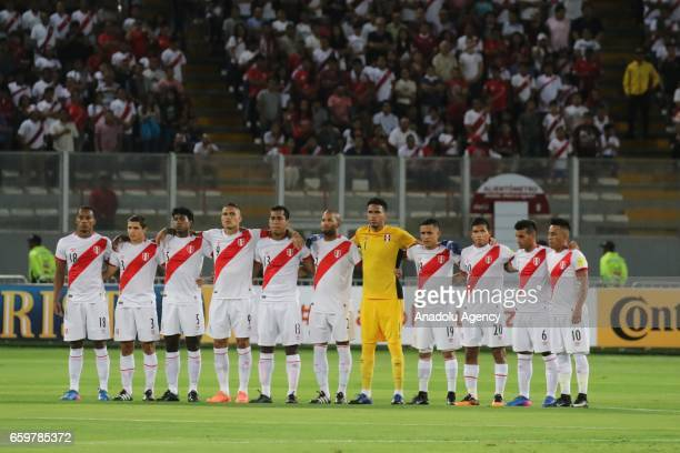 Peru team players stand in silence before 2018 FIFA World Cup Qualification match between Peru and Uruguay at National Stadium in Lima Peru on March...