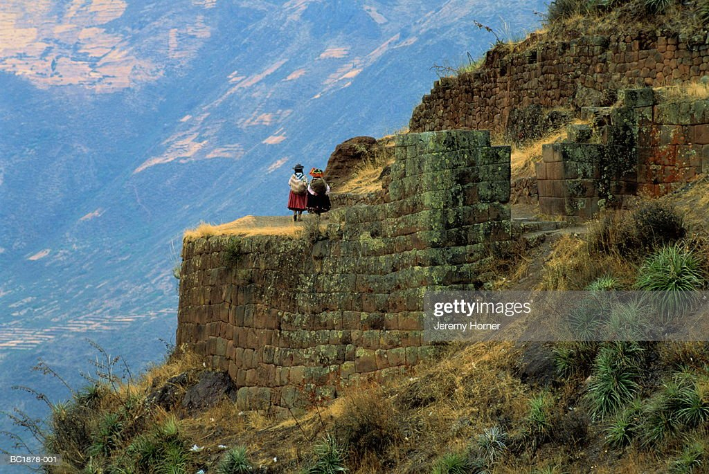 Peru,Cuzco,Urubamba Valley,Pisac, people walking through Inca ruins