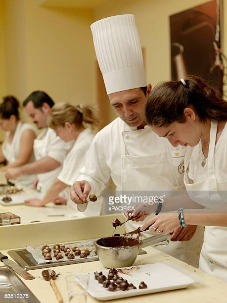 A Perugina Chocolate chef observing a student.