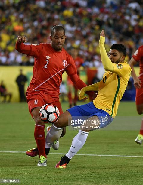 Peru's Alberto Rodriguez and Brazil's Gabriel vie for the ball during their Copa America Centenario football tournament match in Foxborough...