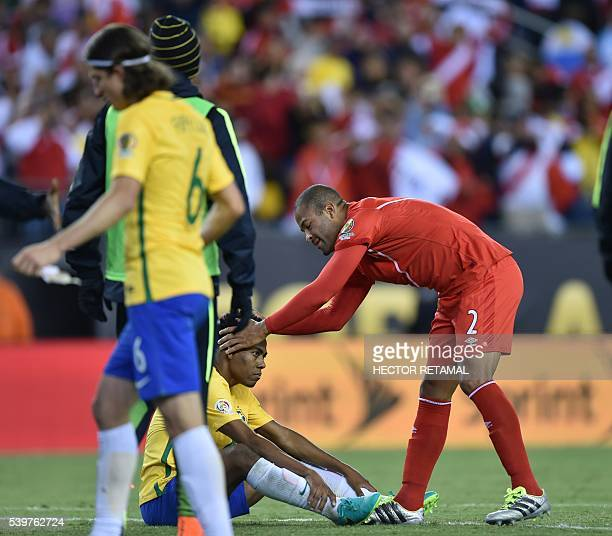 Peru's Alberto Rodriguez comforts Brazil's Elias after defeating them in their Copa America Centenario football tournament match in Foxborough...