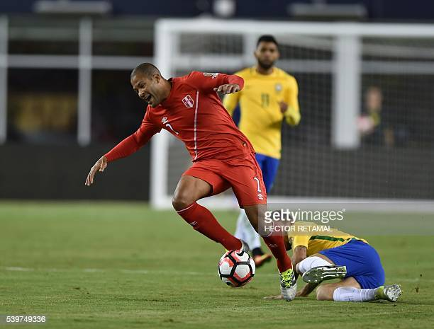 Peru's Alberto Rodriguez is fouled by Brazil's Lucas Lima during their Copa America Centenario football tournament match in Foxborough Massachusetts...
