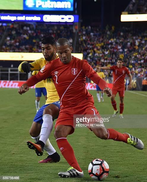 Peru's Alberto Rodriguez is marked by Brazil's Gabriel during their Copa America Centenario football tournament match in Foxborough Massachusetts...