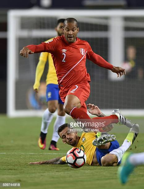 Peru's Alberto Rodriguez is marked by Brazil's Lucas Lima during their Copa America Centenario football tournament match in Foxborough Massachusetts...