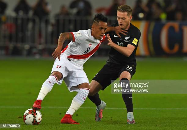 Peru's Christian Cueva and New Zealand's Kip Colvey vie for the ball during their 2018 World Cup qualifying playoff second leg football match in Lima...
