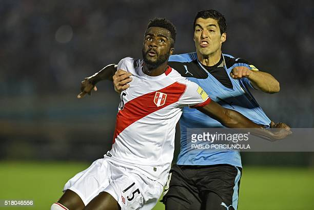 Peru's Christian Ramos and Uruguay's Luis Suarez vie for the ball during their Russia 2018 FIFA World Cup South American Qualifiers' football match...