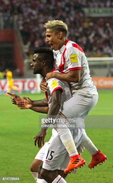Peru's Christian Ramos is embraced by his teammate Peru's Raul Ruidiaz after scoring against New Zealand during their 2018 World Cup qualifying...