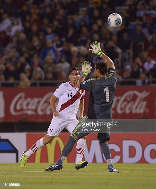 Peru's Claudio Pizarro scores the first goal against Argentina's Sergio Romero during a match between Argentina and Peru as part of the 17th round of...
