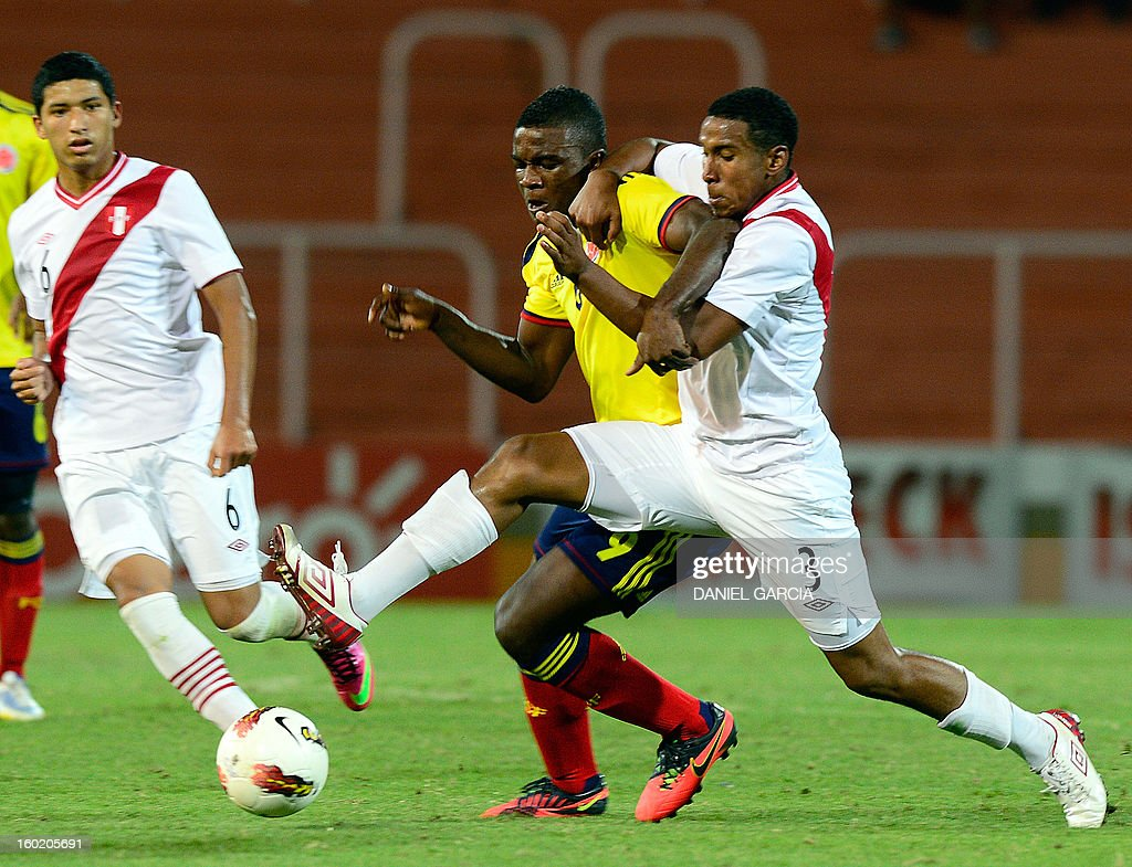 Peru's defender Marcos Ortiz vies for the ball with Colombia's forward Jhon Cordoba during their South American U-20 final round football match at Malvinas Argentinas stadium in Mendoza, Argentina, on January 27, 2013. Four South American teams will qualify for the FIFA U-20 World Cup Turkey 2013.
