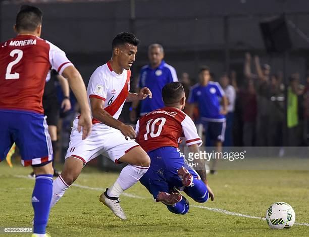 Peru's defender Miguel Trauco and Paraguay's Derlis Gonzalez vie for the ball during their FIFA 2018 World Cup qualifier football match in Asuncion...