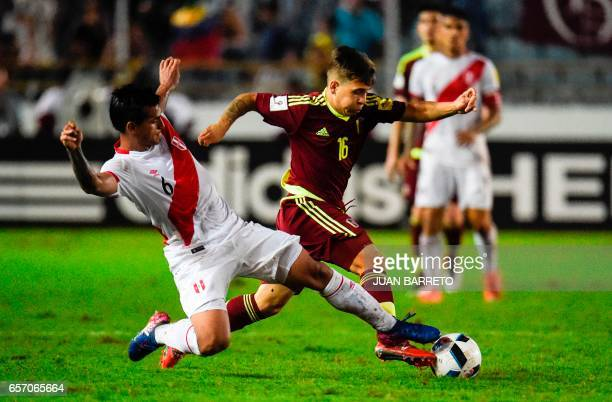 Peru's defender Miguel Trauco vies for the ball with Peru´s midfielder Sergio Pena during their 2018 FIFA World Cup qualifier football match in...