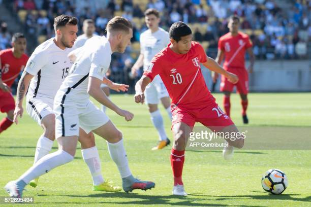 Peru's Edison Flores controls the ball next to New Zealand's Kip Colvey during the World Cup football qualifying match between New Zealand and Peru...
