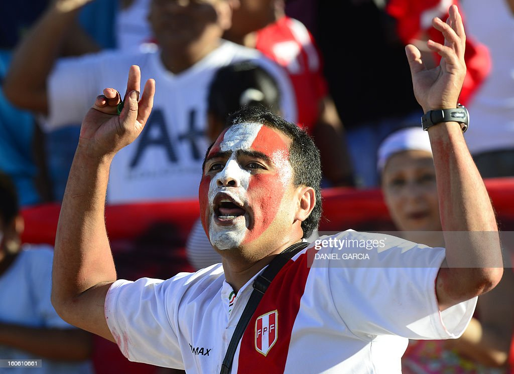 A Peru's fan cheers for his team before the South American U-20 final round football match against Chile at Malvinas Argentinas stadium in Mendoza, Argentina, on February 3, 2013. Four teams will qualify for the FIFA U-20 World Cup Turkey 2013.
